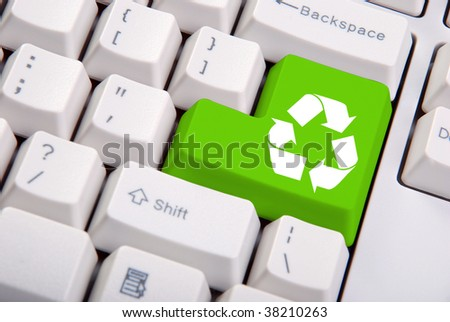 recycle symbol on the computer keyboard in green
