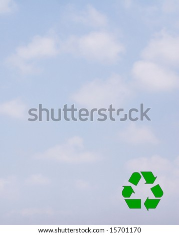 Recycle Symbol over a cloudy sky.