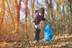 Recycle waste litter rubbish garbage trash junk clean training. Nature cleaning, volunteer ecology green concept. Young men and boys pick up spring forest at sunset. Environment plastic pollution