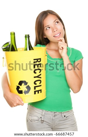Recycle woman thinking looking up at copy space. Beautiful young woman holding recycling basket isolated on white background.