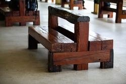 Recycle wooden chair made of wooden railway sleepers in train station.