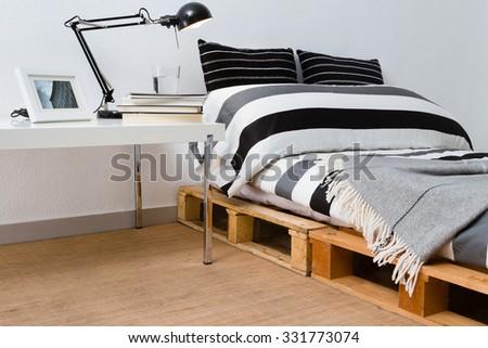 Recycled diy pallet platform bed in modern bedroom