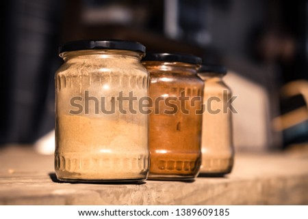 Recycled jars used as food containers.