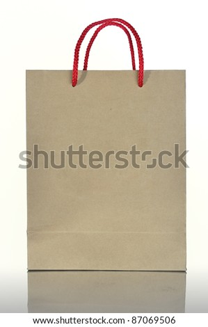 Recycled paper bag isolated on white background