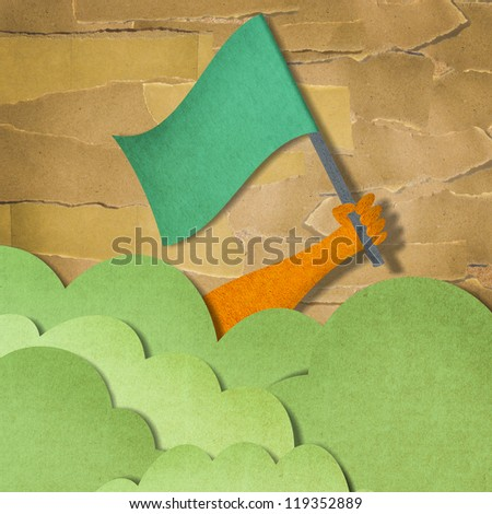 recycled paper craft stick on background ,Green world and safe world concept. - stock photo