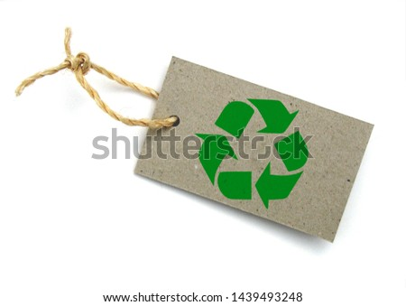 Recycled paper label with pictogram: recycling #1439493248