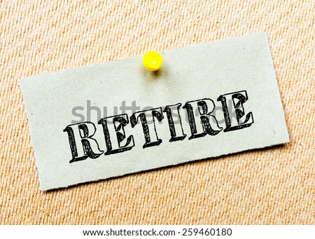 Recycled paper note pinned on cork board. Retire Message. Concept Image