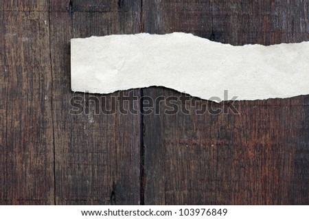 recycled paper ripped on real wood background