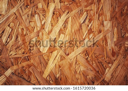 Recycled wood texture from compressed wood chippings and strands or oriented strand board, osb with soft glow and classic vintage effect