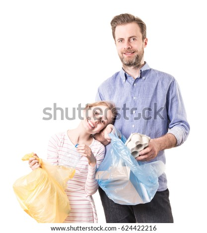Recycling and ecology - father and daughter sorting (segregating) household waste - isolated on white background. Ecological education and awareness concept. #624422216