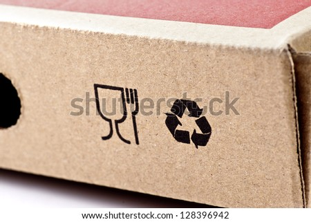 recycling and fragile symbols printed on a cardboard box;