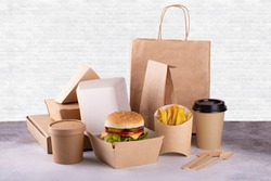 Recycling concept. Delivery food background. Fast food eco packaging with tasty hamburger, french fries, paper coffee cup and soup
