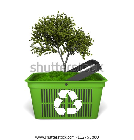 Recycling concept with small tree growing in green shopping basket with recycling logo