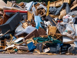 Recycling dump with trash of broken chairs, tables, bed and much more.
