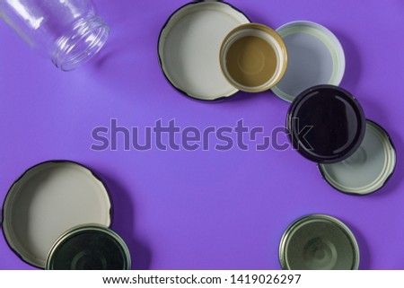 Recycling glass jar lids for reuse of single use items; Zero no waste recycle program campaigns; Recyclable concept on blank empty copyspace, text room space for copy on horizontal purple background. #1419026297
