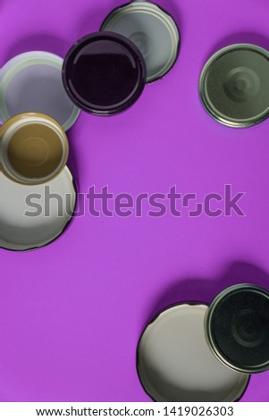 Recycling glass jar lids for reuse of single use items; Zero no waste recycle program campaigns; Recyclable concept on blank empty copyspace, text room space for copy on vertical pink background. #1419026303