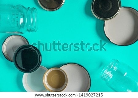 Recycling glass jar lids for reuse of single use items; Zero no waste recycle program campaigns; Recyclable concept on blank empty copyspace, text room space for copy on horizontal cyan background. #1419027215