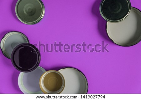 Recycling glass jar lids for reuse of single use items; Zero no waste recycle program campaigns; Recyclable concept on blank empty copyspace, text room space for copy on horizontal pink background. #1419027794