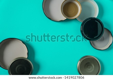 Recycling glass jar lids for reuse of single use items; Zero no waste recycle program campaigns; Recyclable concept on blank empty copyspace, text room space for copy on horizontal cyan background. #1419027806