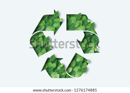 Recycling icon made from green leaves. Light background. The concept of recycling, non-waste production, eco-plastic, eco fuel. #1276174885