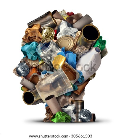 Recycling ideas and environmental garbage management solutions and creative ways to reuse waste as old paper glass metal and plastic bottles shaped as a human head as a symbol for reusable thinking.