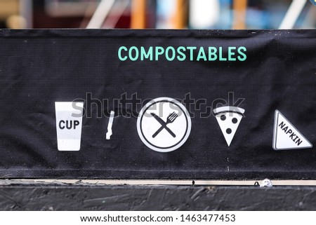 Recycling symbols on garbage bins (compostables and recyclables) #1463477453