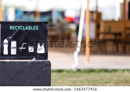 Recycling symbols on garbage bins (compostables and recyclables) #1463477456