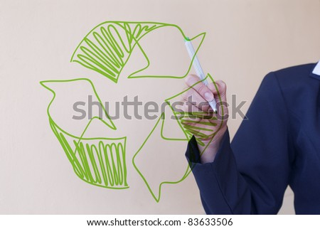 Recycling. Woman drawing recycle sign