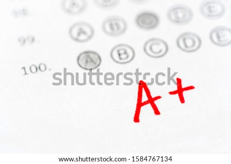Red A plus grade and exam sheet. Excellent, perfect results students on scantron test.