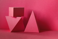 Red abstract geometrical figures background. Beautiful three-dimensional pyramid rectangular cube objects. Platonic solids figures, simplicity concept photography.