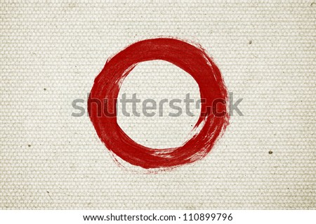 Red abstract hand-painted brush stroke daub circle over vintage old paper