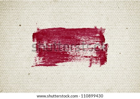 Red abstract hand-painted brush stroke daub over vintage old paper