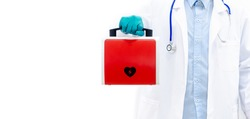 Red AED or defibrillator In the hand of a doctor wearing a blue glove Protruding forward Wear a white coat White background There is a blue stethoscope, a copy space