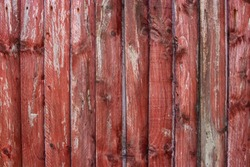 Red aged wood fence panels old rough vintage worn weathered texture background