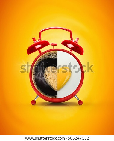 Red alarm clock and fried fried eggs with yolk heart with hot coffee . The original creative idea concept omelette with hot coffee for breakfast. Beautiful bright yellow background. #505247152