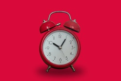 Red alarm clock on a red background