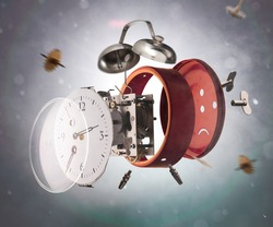 Red alarm clock scatters in parts in explosion