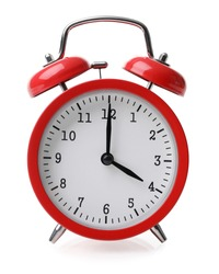 Red alarm clock set at four isolated over white background close-up with clipping path