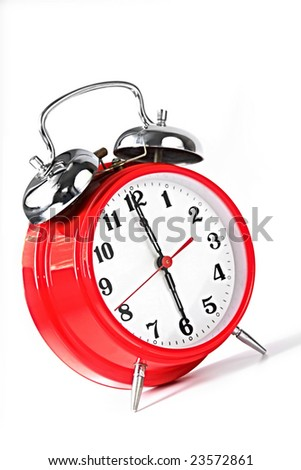 Red alarm clock set to 6.00am.  Natural early morning light.