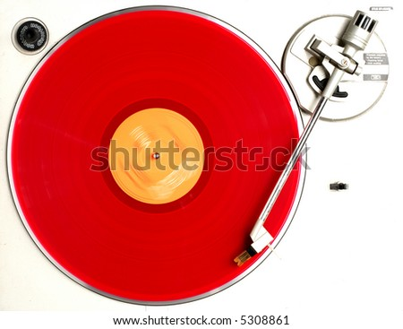 red album on turntable