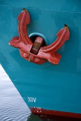 Red anchor on blue vessel. From the harbour at Aarhus, Denmark