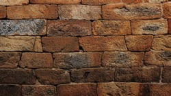 Red Ancient Stone or Rock Wall in India.
