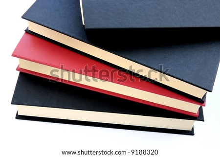 Red and black books stacked on top of eachother isolated on white background - stock photo
