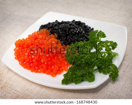 red and black caviar is in a serving plate