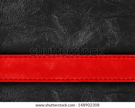 Red and black colored stitched leather close up with seam - stock photo