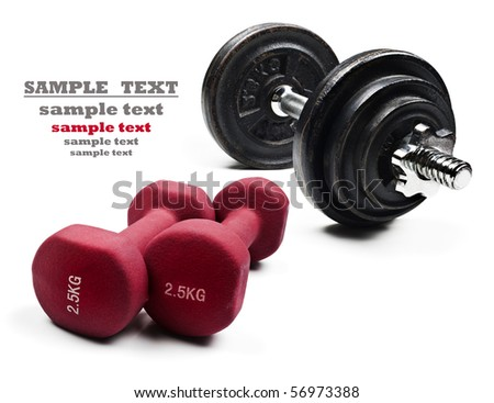 Red and black dumbbells on a pure white background with space for text - stock photo