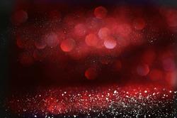 Red and black glitter vintage lights background. defocused