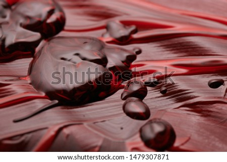 red and black oil paint abstract photos. Artistic flow