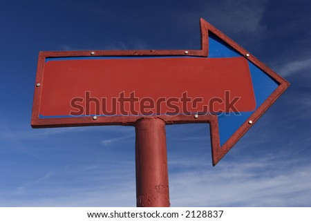 Red and blue arrow sign with blank space that can be used for copy.