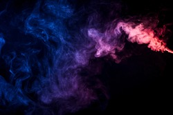Red and blue cloud of smoke of  black isolated background. Background from the smoke of vape